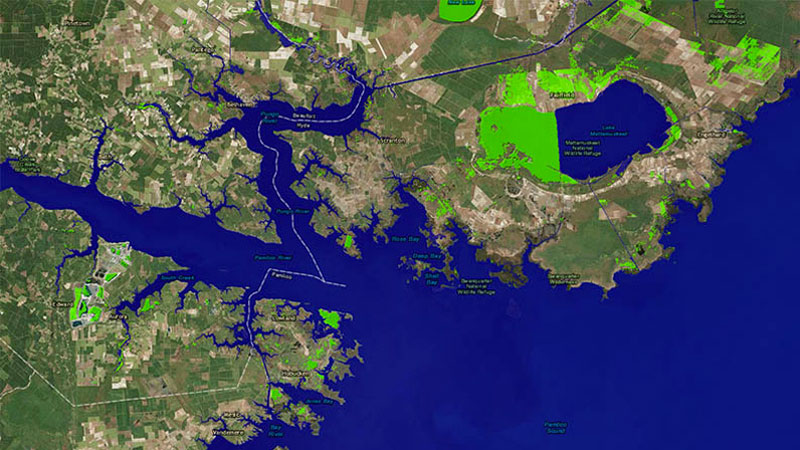 Before: A one-meter rise in sea levels would reshape many U.S. coastlines, including this section of North Carolina's coast. Blue regions show areas submerged by water. Many scientists expect that sea levels will rise by a meter by 2100.