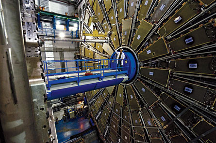 ATLAS is one of the massive laboratories surrounding the huge underground tunnel of the Large Hadron Collider. Protons speeding through the tunnel will collide here, and ATLAS will detect what happens.