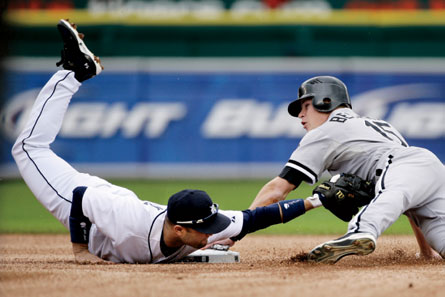 Detroit Tigers second baseman Placido Polanco, a 2009 Gold Glove winner, applies the tag as Chicago White Sox's Gordon Beckham slides into second. Image credit: Duane Burleson - file