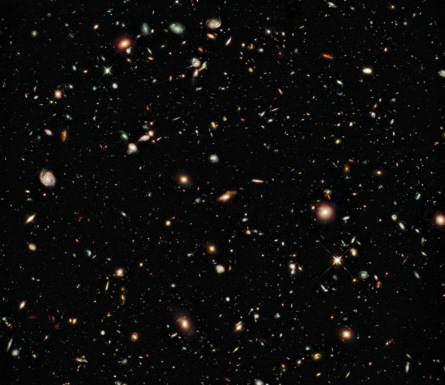 Some of the faintest and reddest objects in this Hubble Space Telescope image, taken in August 2009, may date from only about a half billion years after the Big Bang. The near-infrared image, of a region called the Hubble Ultra Deep Field, was taken with Hubble's new Wide Field Camera 3. Credit: NASA, ESA, G. Illingworth, R. Bouwens and the HUDF09 Team