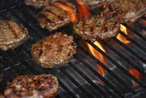 POLLUTING BURGERS | Few grilling methods appear to match charcoal's release of soot and other tiny particles into the air. Credit: iStockphoto