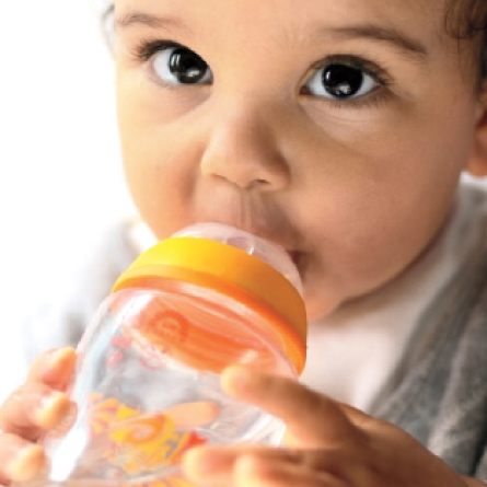 baby drinks from bottle