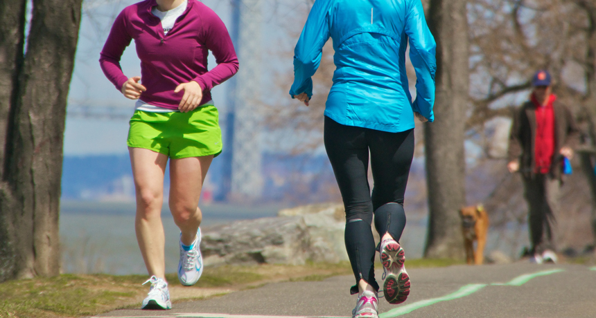 two runners on a path
