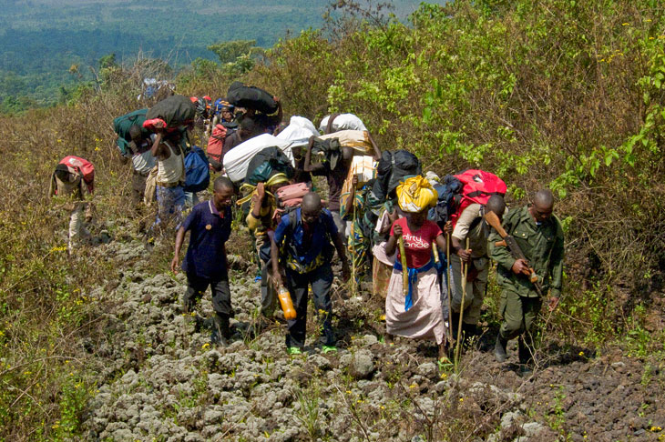 Porters carrying supplies up Mount Nyiragongo