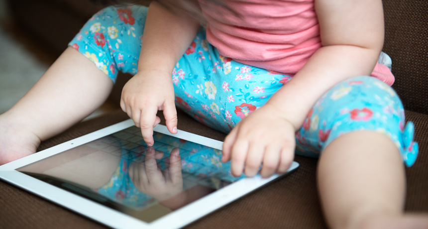 toddler playing on a tablet