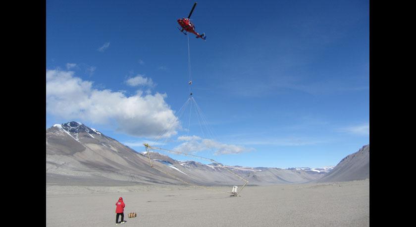 Helicopter over one of Antarctica's frozen dry valleys