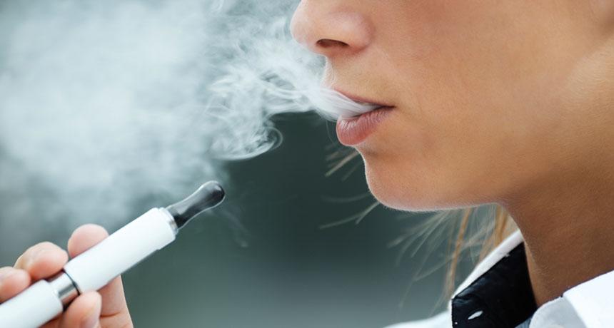 someone smoking an e-cigarette