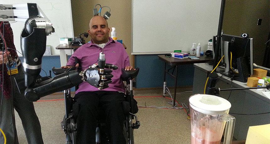 Erik Sorto controls a blender with a robotic arm