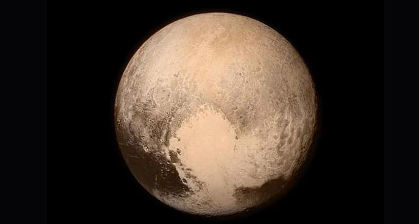 """Pluto and its """"heart,"""" July 13, 2015"""