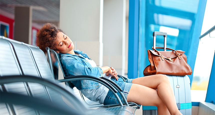 woman asleep in an airport