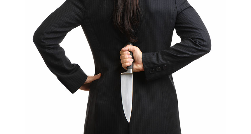 woman holding knife behind her back
