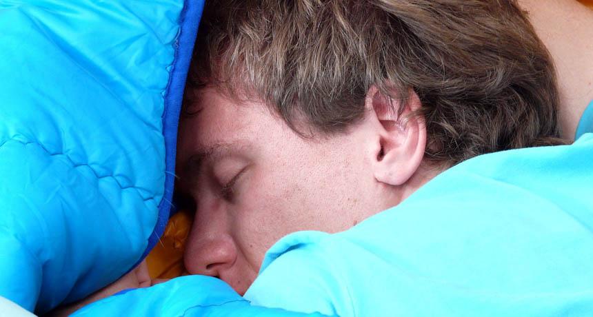 male camper sleeping