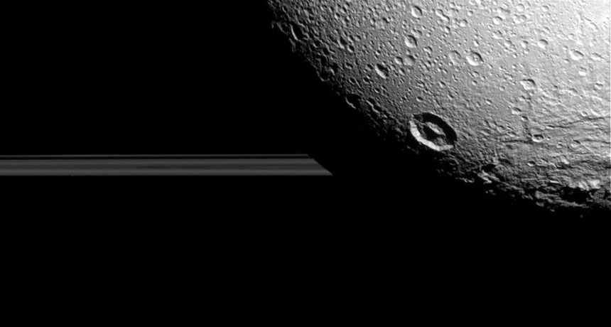 Dione and Saturn's rings, as photographed by Cassini