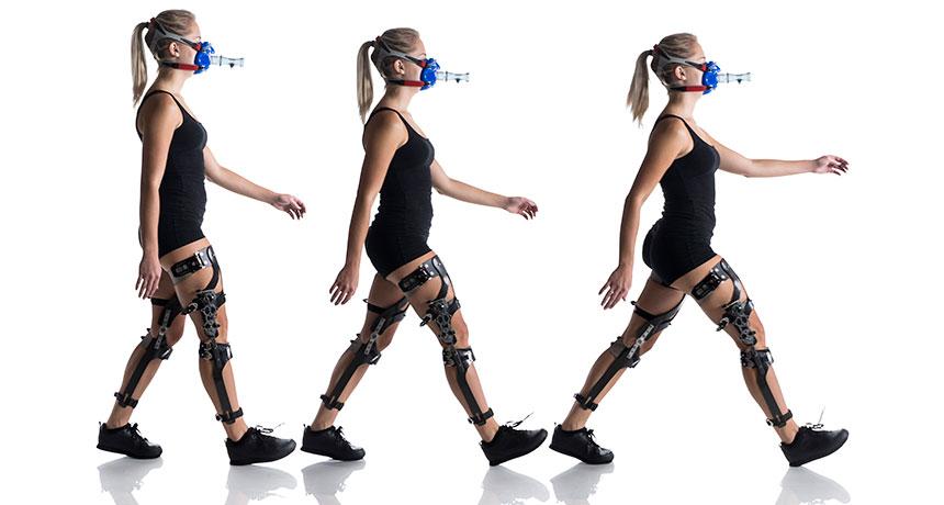 person walking with robotic leg braces