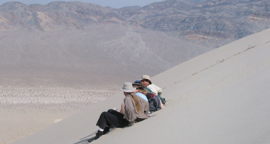 Scientists on dunes