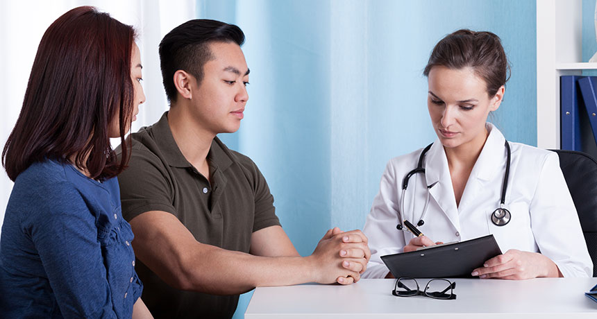 couple talking to doctor