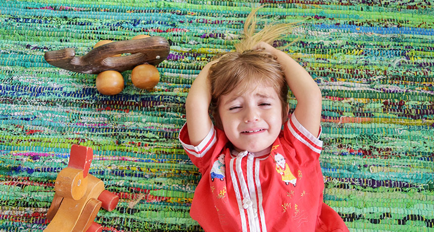 toddler crying on floor