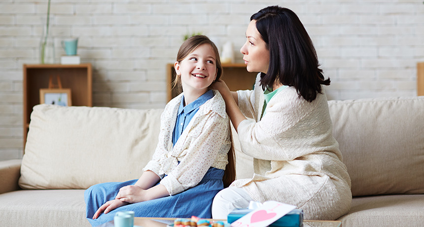 Mom talking to her daughter