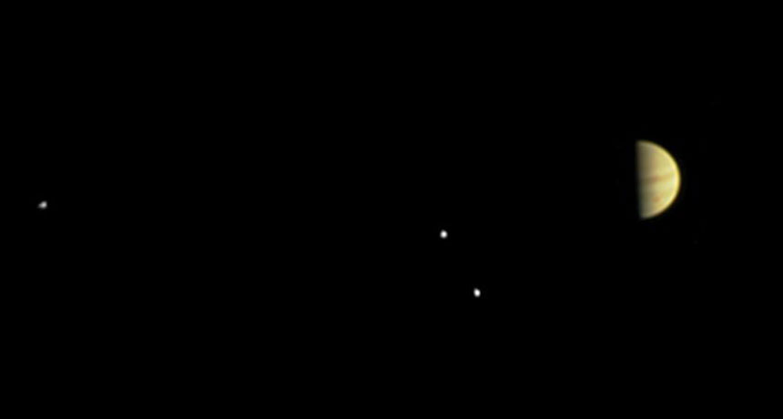 Jupiter and three moons, taken by Juno on June 28, 2016