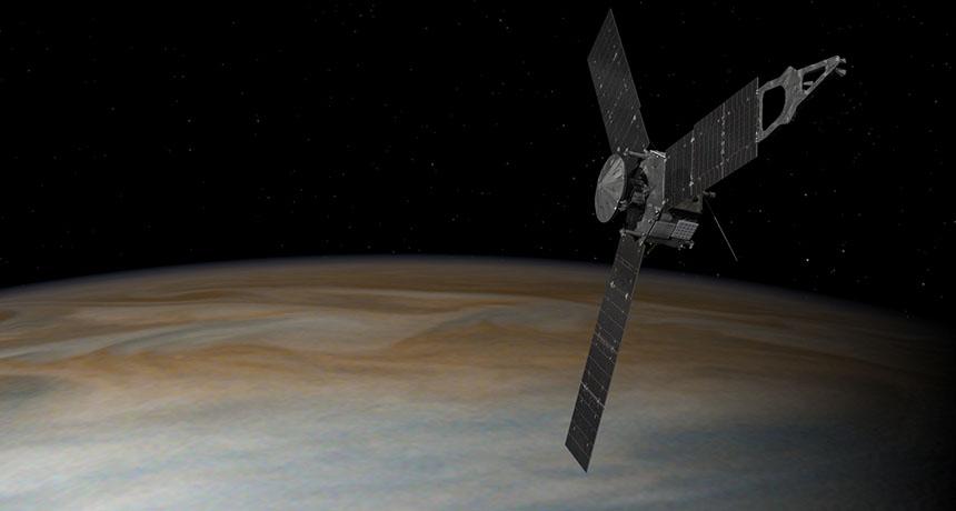 illustration of Juno spacecraft in orbit around Jupiter