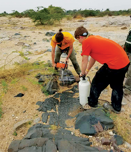 researchers at a dike