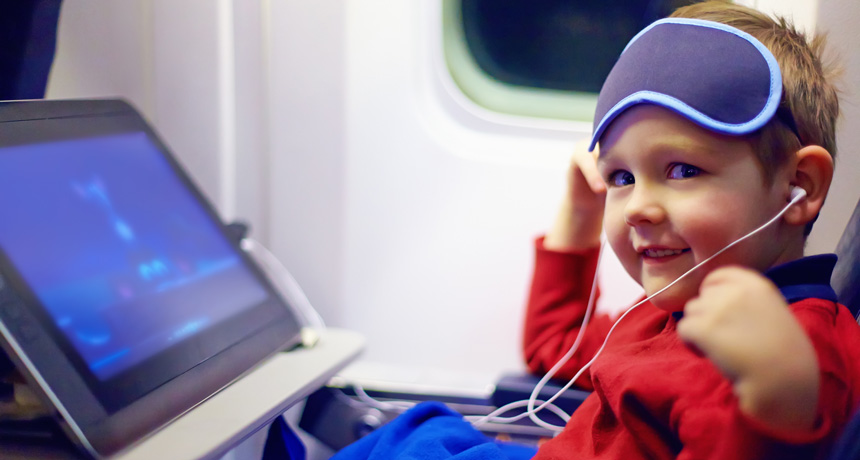 young boy on an airplane