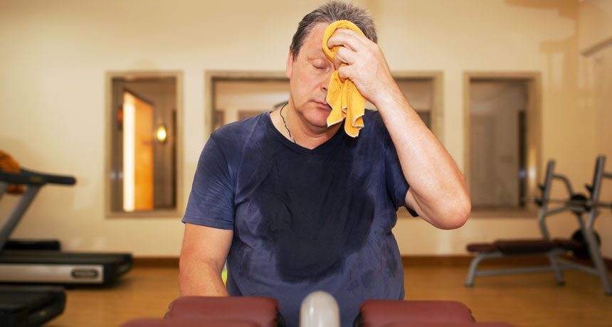 man sweating while working out