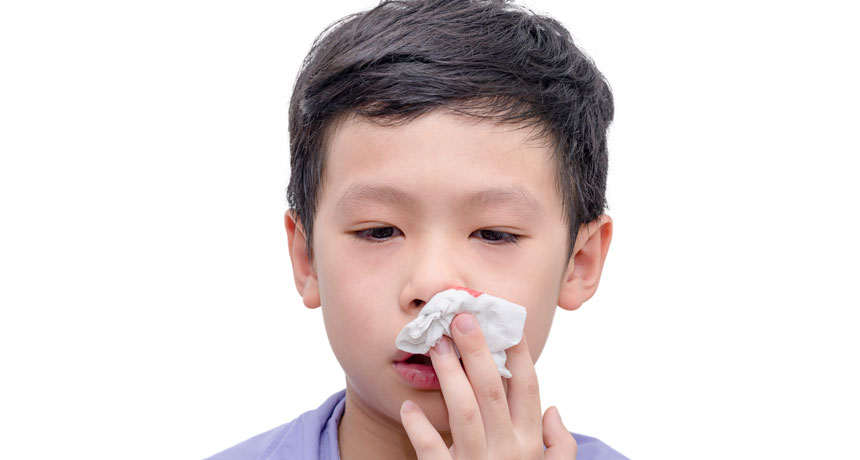 young boy stopping bloody nose