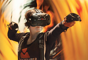 Lady playing a VR game