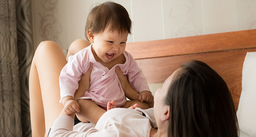 mother and baby laughing and playing