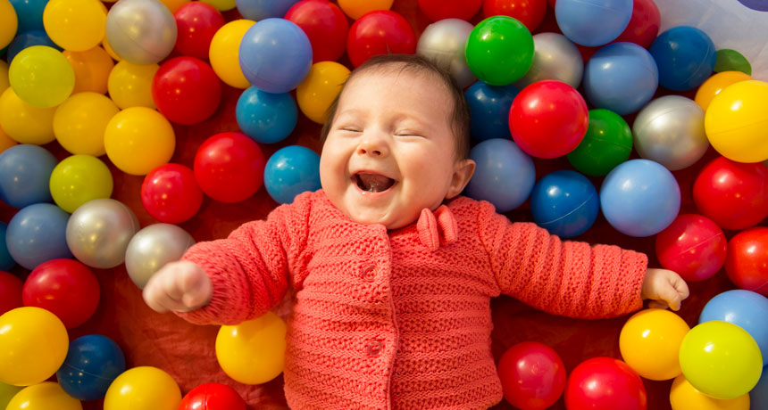 baby in a sensory ball pit