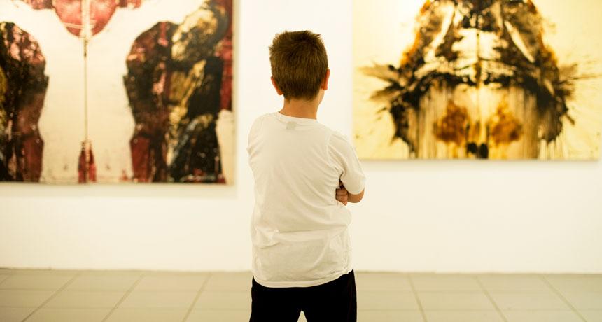kid looking at paintings