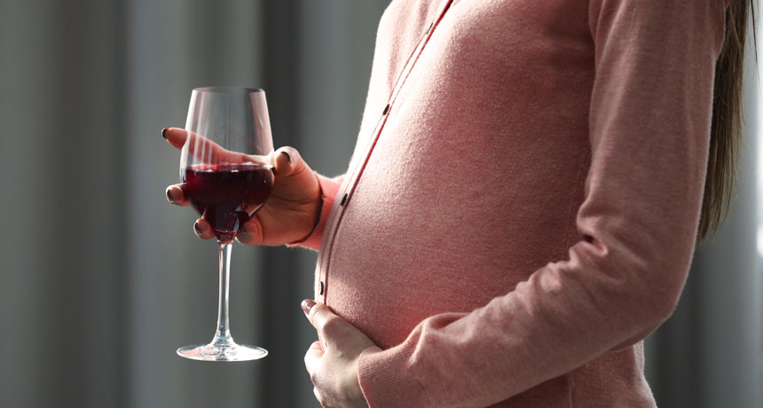 pregnant lady drinking wine