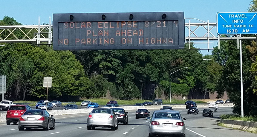 highway sign about eclipse