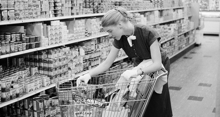 old photo of woman at grocery store