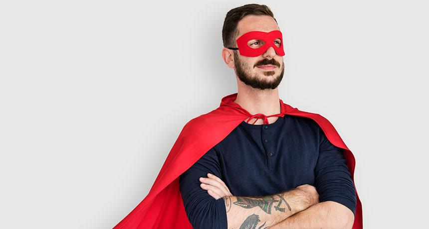 man in superhero costume striking a power pose