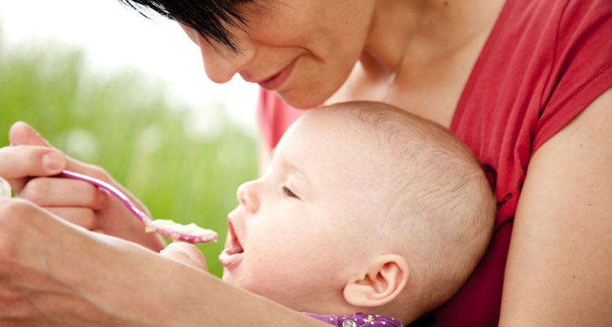 mom feeding a baby