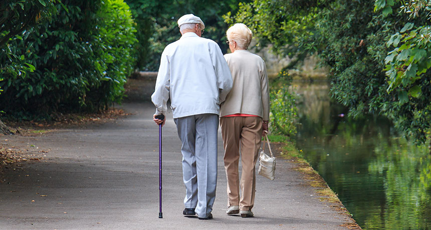 elderly man and woman walking