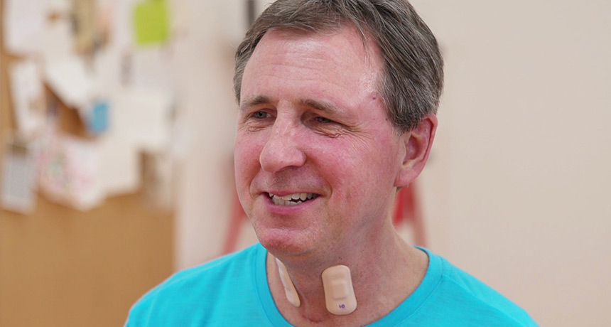 man with sensors on neck