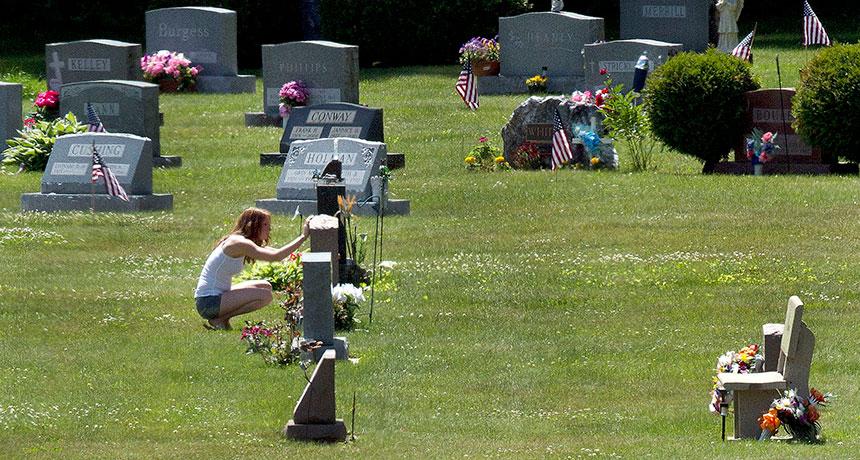 woman visiting grave