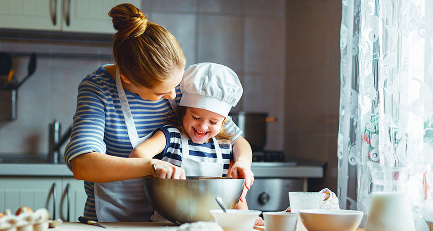 child helping mom bake