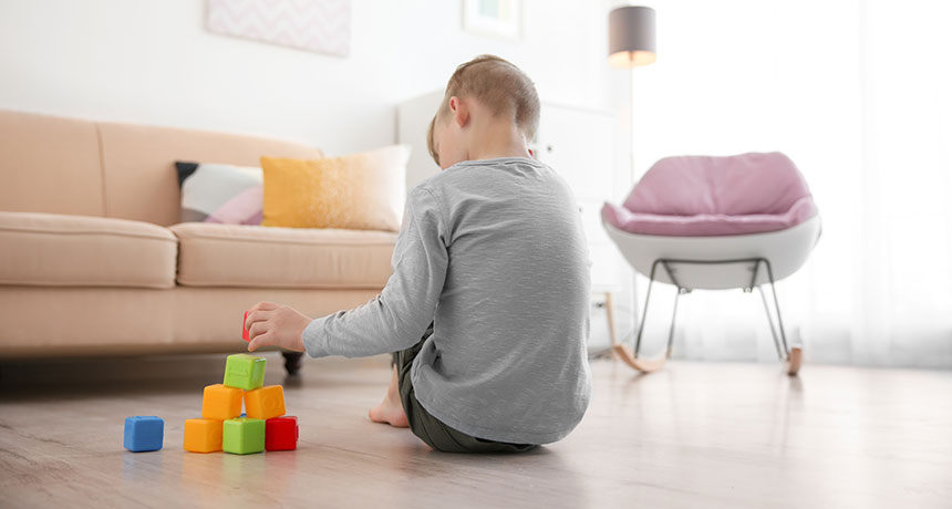 a child playing with blocks on the floor