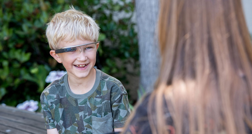 child wearing a Google Glass headset