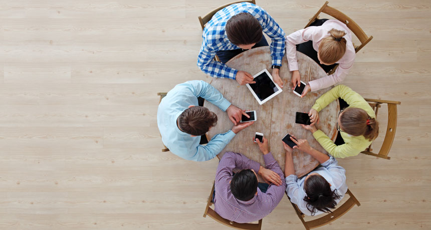 circle of people on personal electronic devices