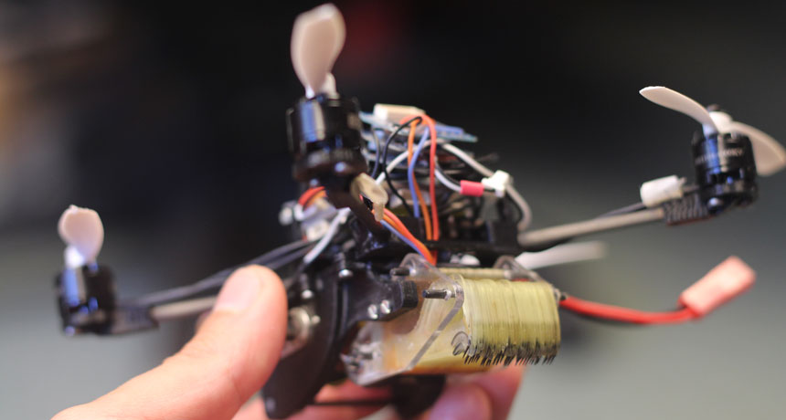 a photo of a small drone held in a person's hand