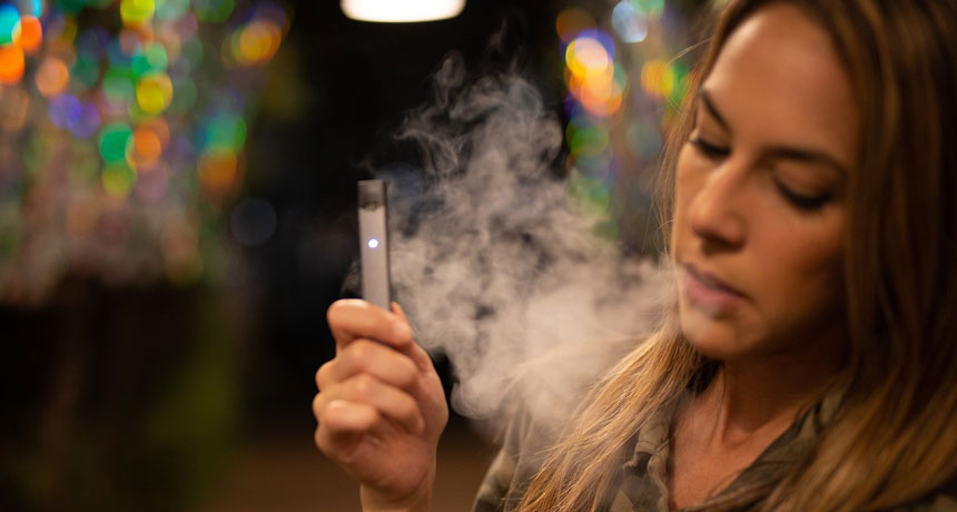 person using an e-cigarette