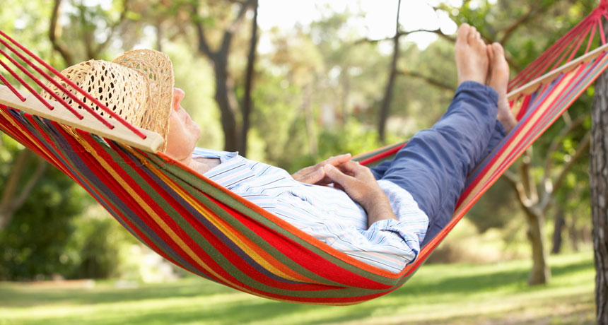 person snoozing in a hammock