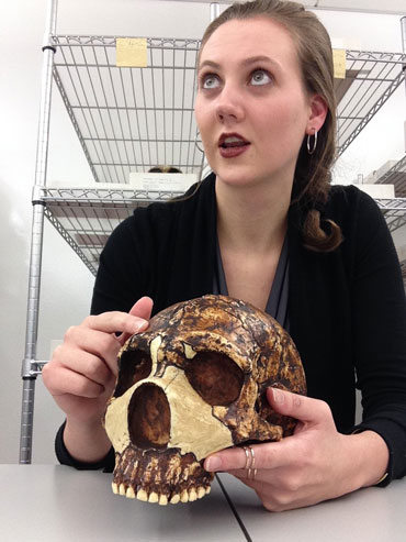 a photo of Kimberly Foecke holding a Neandertal skull