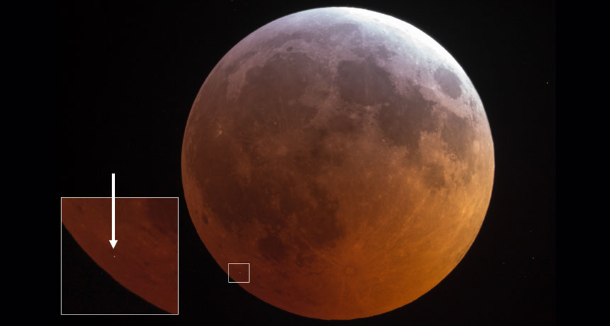 object striking moon during lunar eclipse