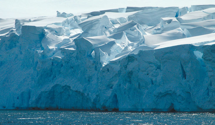 a photo of a glacier on Anvers Island jutting into the ocean